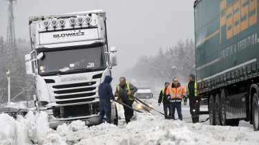 Truck drivers trapped by snow on the motorway near Holzkirchen, Germany.
