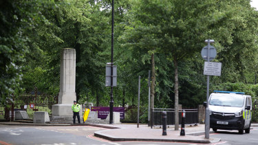Police guard an entrance to Forbury Gardens, where a lone attacker targeted groups of people socialising.