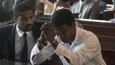 Michael B. Jordan as Bryan Stevenson and Jamie Foxx as Walter McMillian in Just Mercy.