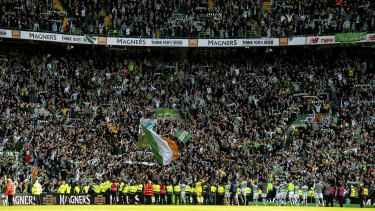 Celtic players celebrate with supporters at Parkhead after an Old Firm victory.