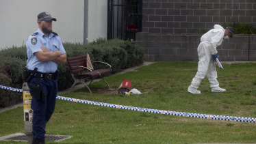 NSW Forensic Services investigating at a crime scene where a man was killed in January 2018 near  Hurstville Train Station.