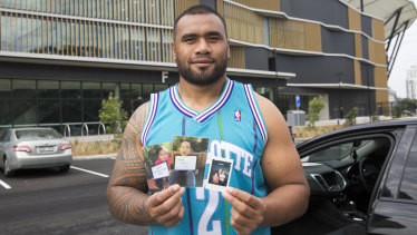 Close to his heart: Junior Paulo carries a photo of his wife and each of his two children everywhere he goes. He and Mele are expecting a third child any day.