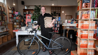 Neighbourhood Books owner Leesa Lambert has closed her store but now offers home delivery by bike or van to the local area.