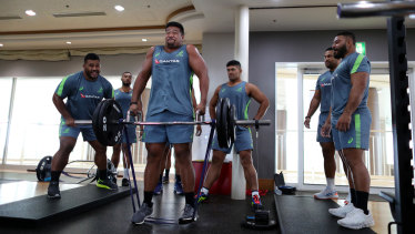 Folau Faingaa, centre, and Tolu Latu, right, are fighting for a starting spot - and pushing each other all the way.