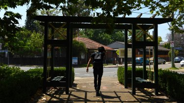 A man under the entrance as he leaves Hammond Park in Ashfield, Sydney.