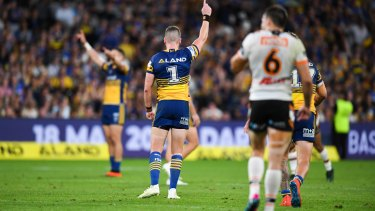 Celebration: off-contract stars Mitchell Moses and Clint Gutherson salute their efforts on Monday.