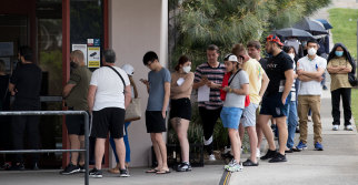 People queue outside Centrelink at Rockdale on Tuesday.
