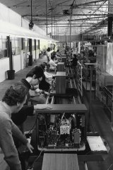 Technicians at National's manufacturing plant at Penrith, work on Pana-Colour TV sets on December 27, 1974.