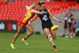 Nicola Stevens gets a kick away for the Blues at Metricon Stadium on Friday night.