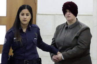 Australian Malka Leifer, right, is brought to a courtroom in Jerusalem  in 2018.
