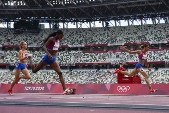 Americans Sydney McLaughlin (right) and Dalilah Muhammad hit the finish line.