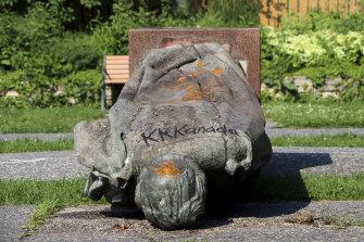 A statue of Queen Elizabeth II is seen overturned and vandalised in Winnipeg.