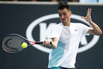 Bernard Tomic in action against American Denis Kudla during 2020 Australian Open qualifying.