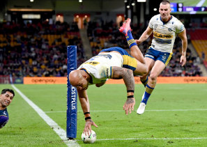 Eels winger Blake Ferguson takes the aerial route to the try line.