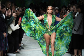 Still iconic ... J-Lo closes Versace's Milan Fashion Week show in an update of her 2000 Grammys dress.