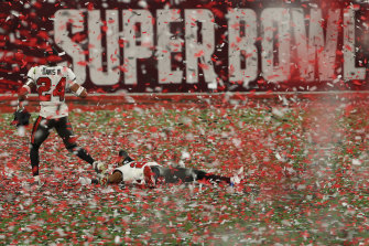 How sweet it is: Carlton Davis of the Tampa Bay Buccaneers runs through the confetti shower.