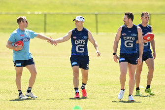 Back in the fold: Gary Ablett greets Geelong assistant coach Matthew Knights.