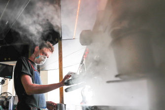 Steam and smoke: barista Alex Cooper at work on the GPO Building porch.