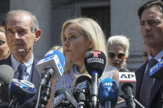 Virginia Roberts Giuffre, who says she was trafficked by Jeffrey Epstein, holds a news conference outside a Manhattan court with her lawyer in August, 2019.
