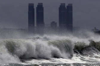 High waves whipped up by typhoon Bavi crash onto Haeundae Beach in Busan, South Korea, on Wednesday.
