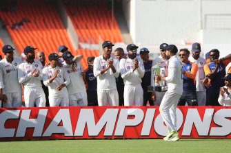 Virat Kohli and his teammates celebrate India's victory in the fourth Test against England in Ahmedabad.