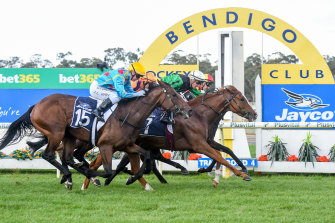 Jockey Daniel Stackhouse rides Riddle Me That to victory during Golden Mile Race Day at Bendigo Racecourse.