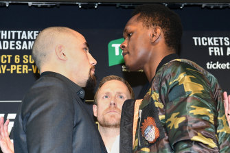 Israel Adesanya faces off with Robert Whittaker.