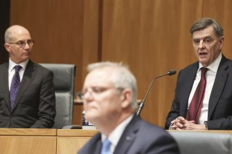 Acting Chief Medical Officer Professor Paul Kelly, Prime Minister Scott Morrison and Secretary of the Department of Health Professor Brendan Murphy during a national cabinet press conference.
