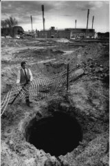 """Mr. Noel Neate beside the well named """"Busby's Bore"""" found during the construction of the Sydney Football Stadium, May 20, 1986."""