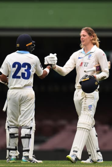 Centurions: Jack Edwards (right) is congratulated by Sangha after reaching his own milestone.
