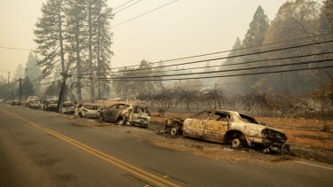 Abandoned vehicles line a road after a fire tore through the Californian town of Paradise last month.
