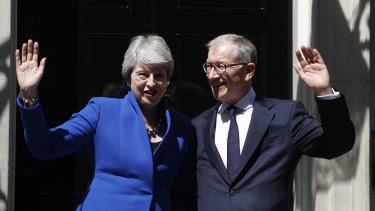 Britain's now former prime minister Theresa May and her husband Philip outside 10 Downing Street.