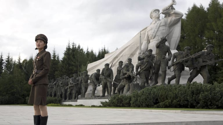 A North Korean guide gives a tour of Samjiyon Great Monument in Samjiyon.