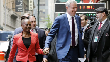 """De Blasio and his wife Chirlane McCray arrive at """"Good Morning America"""" on Thursday."""