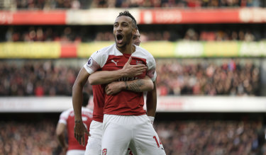 Arsenal's Pierre-Emerick Aubameyang celebrates after scoring the opening goal from the spot against London rivals Tottenham at the Emirates Stadium on Sunday.