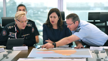 Changing roles: Queensland Fire and Emergency Services Commissioner Katarina Carroll (left), who will be the Police Commissioner from July, Queensland Premier Annastacia Palaszczuk and newly appointed Youth Justice director-general Bob Gee (right)  at a meeting of the Queensland Disaster Management Committee on Tuesday, Tuesday, March 19, in response to Cyclone Trevor.