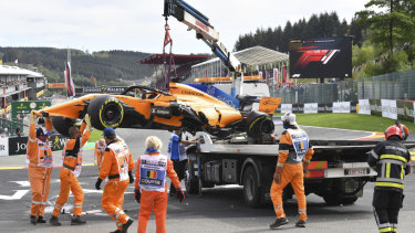 Crew take the car off the track at Spa.