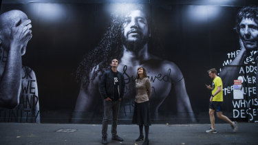 Looking up: Two Good Co director Rob Caslick with Lendlease project director Kimberley Jackson in front of a mural by artist Shannon Crees.