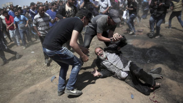 An elderly Palestinian man falls after being shot by Israeli troops at the Gaza Strip's border with Israel last year. Thousands of Palestinians  protested as Israel celebrated the inauguration of a new US embassy in contested Jerusalem.
