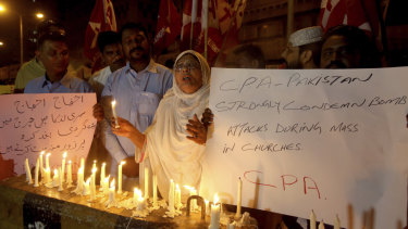 Pakistanis hold a vigil for the for victims of the Sri Lanka attacks, in Karachi, Pakistan.
