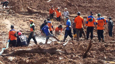 Rescuers search the site of the landslide in central Java on Friday.