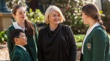 Santa Sabina College principal Dr Maree Herrett, with students wearing the soon-to-be-discontinued uniforms in 2016.