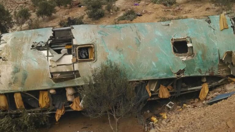 A crashed bus lays on the bottom of a cliff in Arequipa, Peru, killing at least 44.