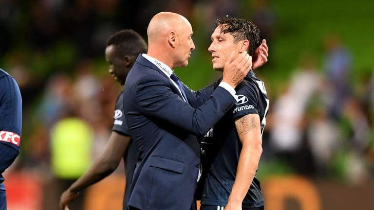 Coach Kevin Muscat with former player Mark Milligan.