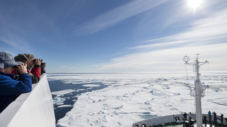 Tourists in the Arctic Ocean in summer. Scientists are hoping to spend a year in a special research vessel in the ice.