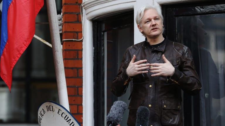 Julian Assange speaks from a balcony at the Ecuadorian embassy in London.