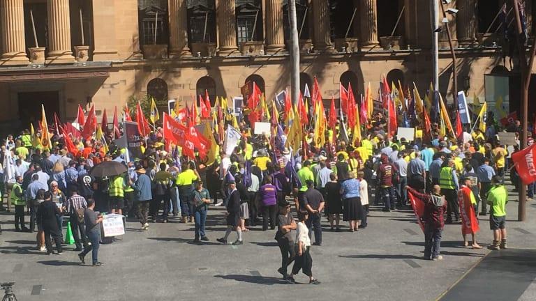 Unions go on strike outside City Hall.