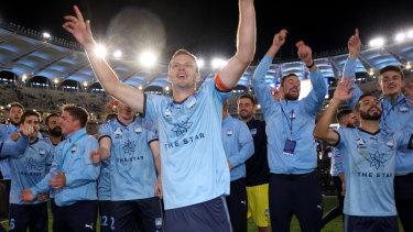 Sydney FC celebrate winning the A-League title on Sunday night.