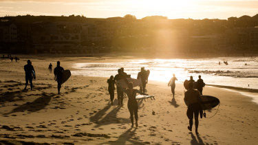 Surfers have returned to Bondi Beach, with restrictions slowly being eased across the state of NSW.