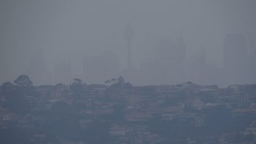 Smoke blankets the city on Friday morning.